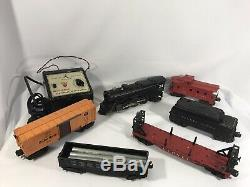 Vintage Lionel Train Set with 2025 Engine, 5 Cars, Tracks, Case + many Accessories